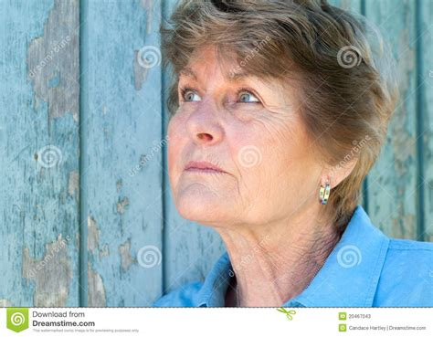 pic of 70 yr old woman lovely 70 year old woman looking up in thought stock image