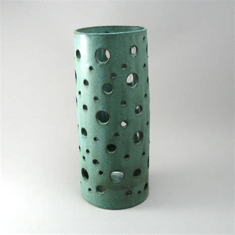 vase in weathered bronze finish by cheryl wolff