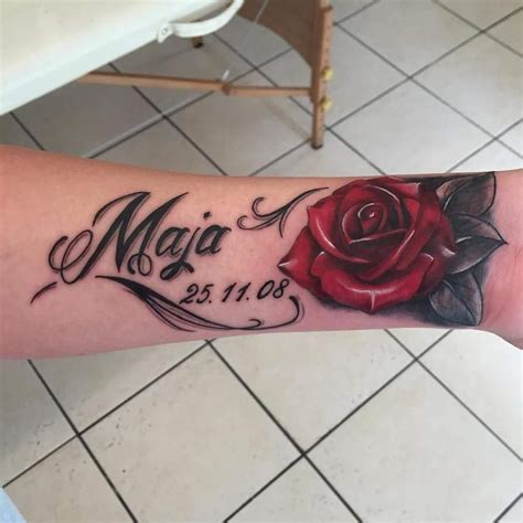 rose and script tattoo script and cover up on an on the wrist