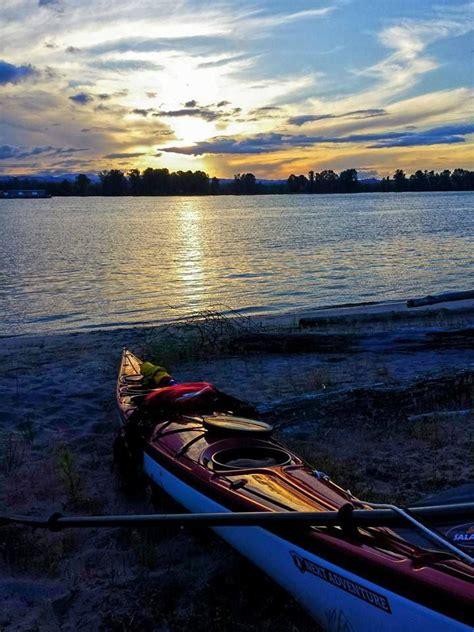 kayak row boats canoes kayaks on the beach at sunset canoes kayaks