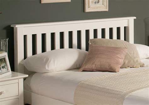 white wooden headboard added by shabby pink and white