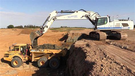 new liebherr r956 excavator loading volvo a30 dumpers