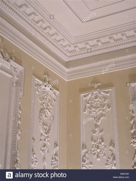 ornate cornice up of plasterwork cornice and ceiling above walls