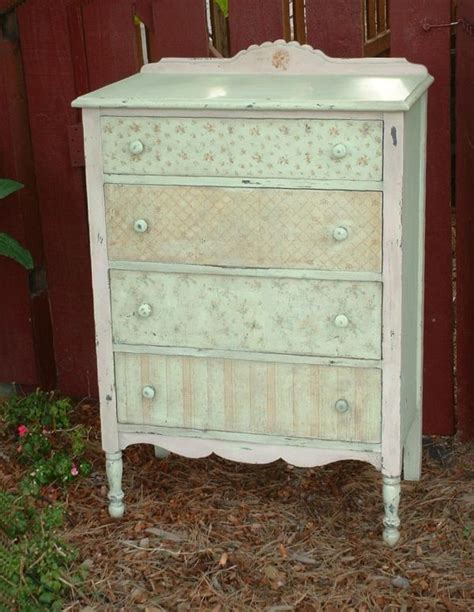 painted antique dresser with drawer fronts covered with