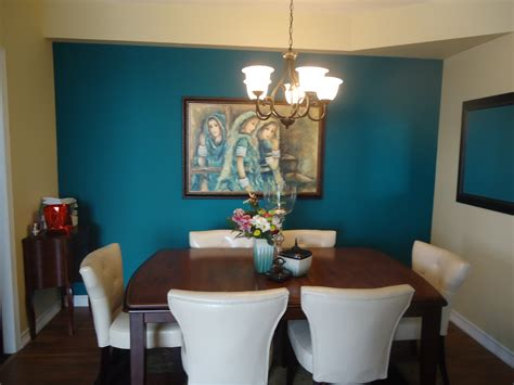 teal accent wall creating a dramatic focal point with artwork small space