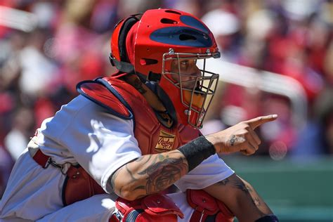yadier molina tattoos meaning yadier molina baseball s secret genius vice sports