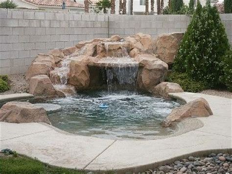 very small backyard pool. grotto. sundeck. table   Very