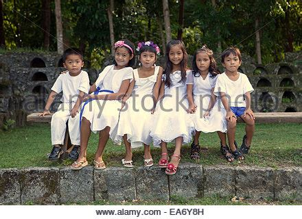 bench kids philippines six years old southeast asian school girl arms up in the