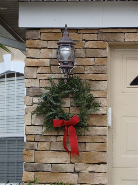 decorations to hang outside of houses wreath outdoor using free tree trimmings from home depot winter decor