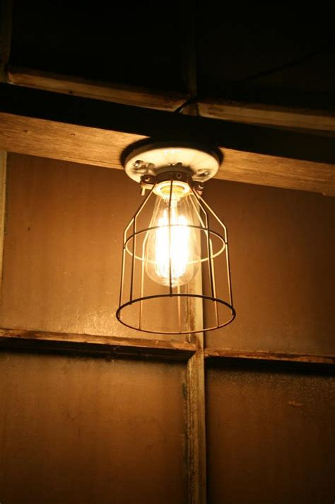 Vintage Industrial Style Porcelain Light Fixture With Metal Cage Farmhouse Ceiling by Industrial Light Vintage Style Porcelain Mount By Industrialrewind