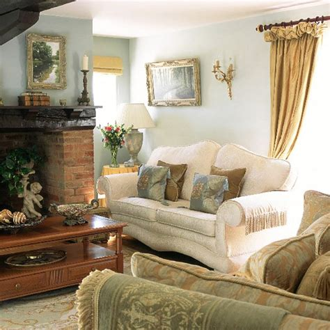 country home living room blue living room with traditional furniture and gold accessories housetohome co uk