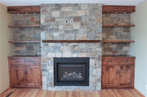custom fireplaces and more custom fireplace feature wall with cabinets a live edge