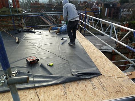 an epdm or rubber roof looks and feels like a new epdm rubber flat roof going new osb roof