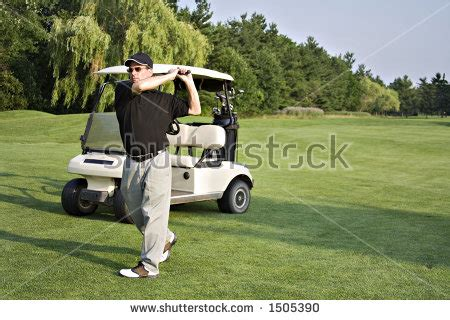 hitting or swinging golf golf course action players hitting greens stock photo