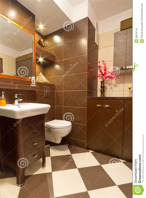 bathroom interior with brown and beige tiles stock photo