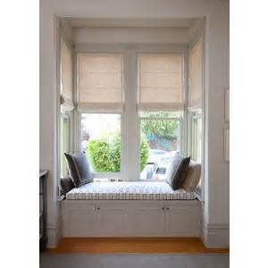 Roman shades in a bay window and built in window seat polyvore