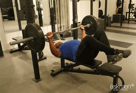 bench press feet up feet up bench press the guide to a bigger bench press askmen
