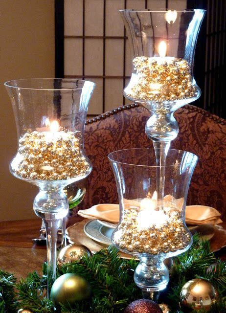 beaded garland for candles gold bead garland in glasses w candles tis the season