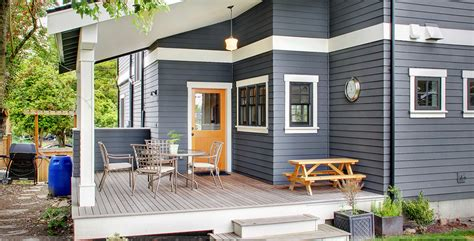 how to paint wood siding on a house siding painting living colour painters