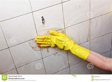 cleaning dirty bathroom tiles cleaning of dirty old tiles in a bathroom stock photos image 34023573