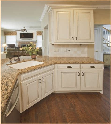 granite for white kitchen cabinets 30 off white kitchen cabinets with antique brown granite