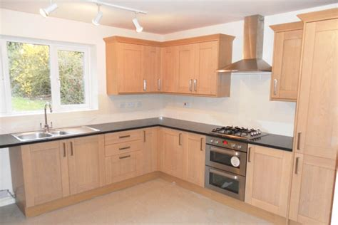 White And Wood Kitchen by Kitchen Fitter Glossop