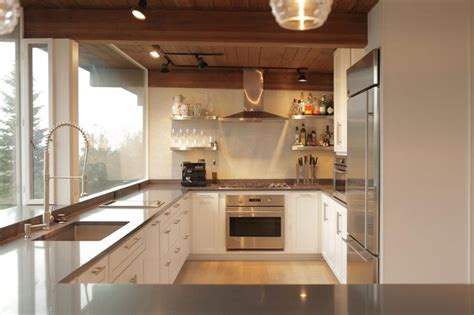 contemporary kitchen cabinets for a posh and sleek finish sleek gray countertops look clean and crisp against the