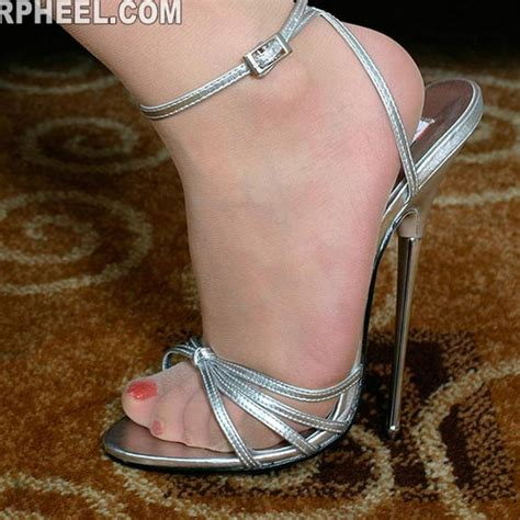 Sandal Wedgest Dh 171 the new ultra high shoes with silver metal with nightclub