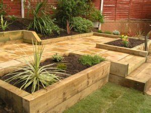 Garden Design Using Sleepers by Brick Block And Sleeper Retaining Walls