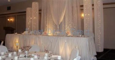 Easy back drop for head table at the wedding reception