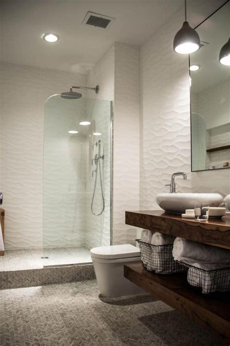 sleek sculptural master bathroom  hgtv