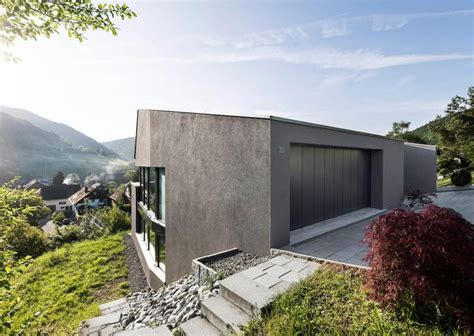 houses built on slopes single family house built on a steep slope that leads to