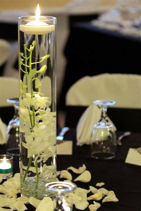 """submerged orchid wedding centerpiece with floating candle"