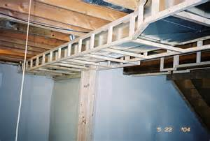 basement hvac ducting soffit around heating ducts in room
