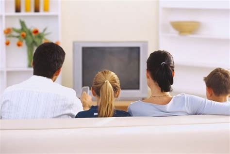 asian family watching tv together in living room this is did or does your whole family watch tv together