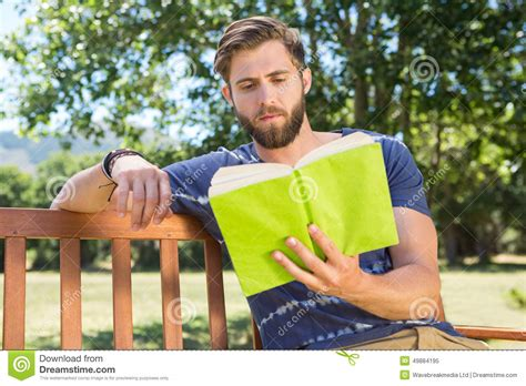 bench day young man reading on park bench stock image image 49884195