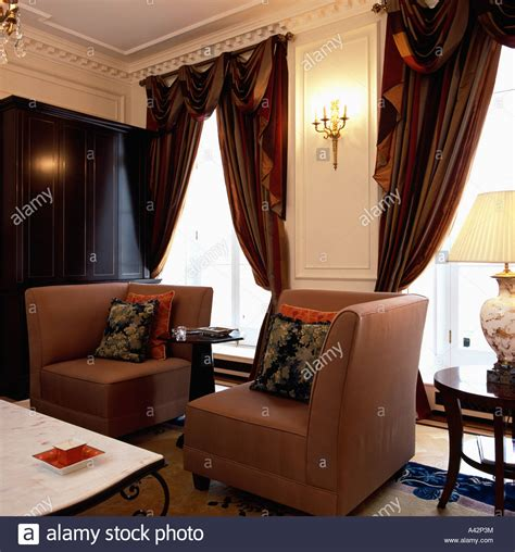 heavy silk curtains corner armchairs and heavy brown silk curtains on tall