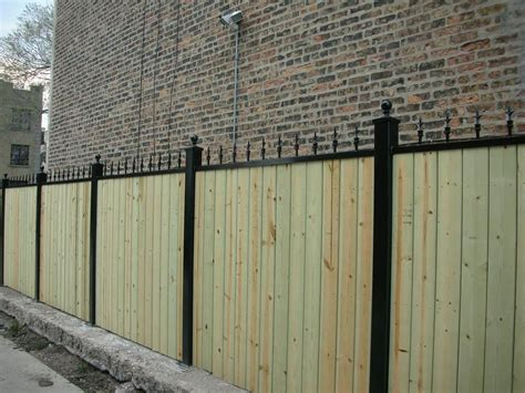 wood fence with iron fences