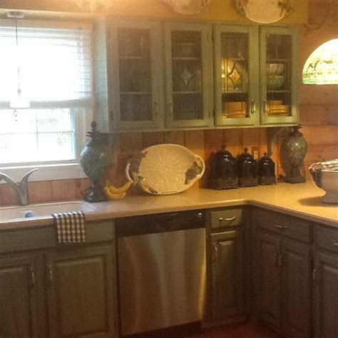 kitchen cabinets on knotty pine walls painted cabinets turquoise with brown glaze knotty pine