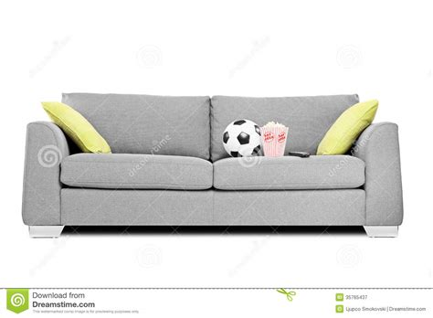 how to shoo a couch studio shot of a modern couch with soccer ball and popcorn
