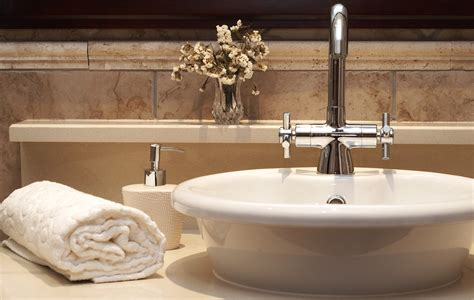 Beautiful Bathroom Sinks | beautiful sink in a bathroom with rolled up towel next to