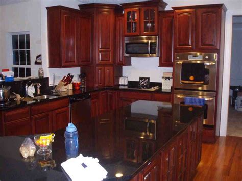 Granite And Cabinets Direct by Black Granite Kitchen Countertops With Cherry Cabinets