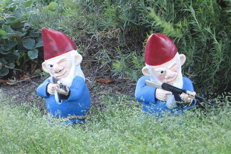 garden gnomes with guns gun toting garden gnomes go on the offensive