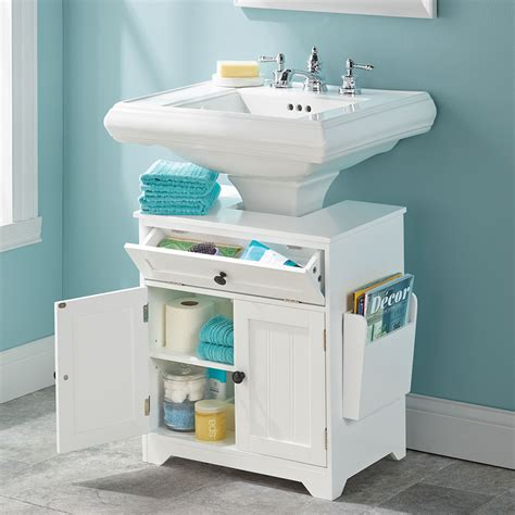bathroom sink storage the pedestal sink storage cabinet hammacher schlemmer