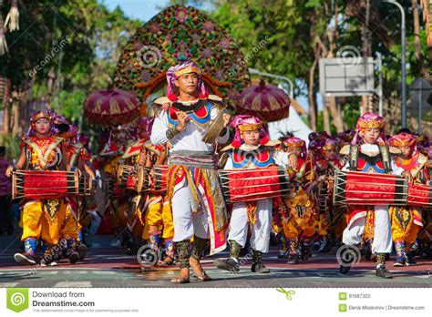 Group Of Balinese Men In Traditional Costumes Play Gamelan