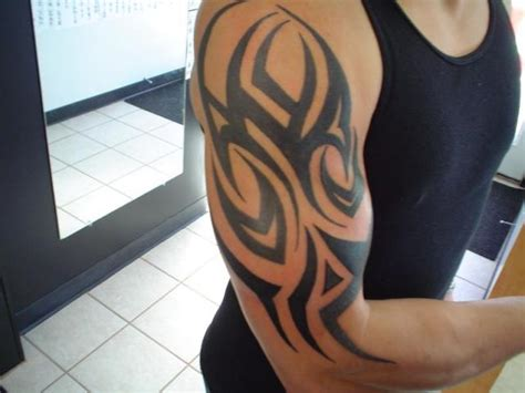 tribal sleeve tattoos for mens arms half sleeve tribal designs archives