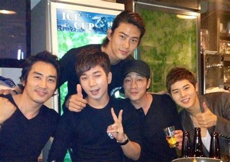 so ji sub and song seung heon song seung heon poses with g o taecyeon so ji sub and