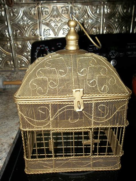 vintage ornate metal wire mesh bird cage or victorian