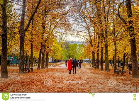 a walk in the romantic couple taking a walk in the park in autumn editorial stock photo image 78749838