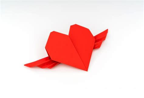 Origami Ocarina - paper origami with wings on white background
